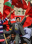 A Palestinian supporter of the Democratic Front for the Liberation of Palestine (DFLP) carries party flag during a rally celebrating 42 years since its founding in Gaza City, Saturday, Feb. 26, 2011. Founded in 1969 the DFLP is a Palestinian Marxist-Leninist, secular political and military organization. Photo by Ashraf Amra