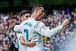 Cristiano Ronaldo of Real Madrid celebrates with teammate Marco Asensio Willemsen during the La Liga 2017-18 match between Real Madrid and Sevilla FC at Santiago Bernabeu Stadium on 09 December 2017 in Madrid, Spain. Photo by Diego Souto / Power Sport Images