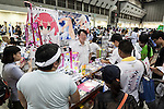 Visitors look at manga books during the ''Comic Market 88 Summer 2015'' exhibition at Tokyo Big Sight on August 14, 2015, Tokyo, Japan. Thousands of manga and anime fans attended the first day of the Comic Market 88 (Comiket) at Tokyo Big Sight. The Comic Market was established in 1975 to allow fans and artists to interact and focuses on manga, anime, gaming and cosplay. The exhibition is held from August 14th to 16th and Comiket organisers expect more than 500,000 visitors to attend. (Photo by Rodrigo Reyes Marin/AFLO)