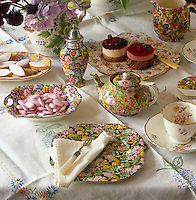 Afternoon tea is set out on chintzware in a mixture of styles, patterns and vintage