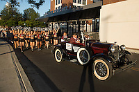 2015 Homecoming Grand Marshal Richard E. Holmes leads the parade past Davis Wade Stadium in the Cowbell Cruiser. Reared in Starkville, Holmes became the first African American student admitted to MSU in 1965. A retired physician and longtime Columbus resident, he also will be recognized during Saturday&rsquo;s [Oct. 17] football game versus Louisiana Tech. Kickoff is scheduled for 11 a.m. at Davis Wade Stadium. The game also is being televised on the SEC Network.<br />
