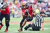 College Park, MD - OCT 1, 2016: Maryland Terrapins wide receiver D.J. Moore (1) runs over the referee on his way to  a first down during game between Maryland and Purdue at Capital One Field at Maryland Stadium in College Park, MD. The Terps got the win 50-7 over visiting Purdue. (Photo by Phil Peters/Media Images International)