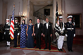 U.S. President Barack Obama (R), first lady Michelle Obama (2nd L), British Prime Minister David Cameron (3rd L) and his wife Samantha Cameron (L) pose for an official photo at the Grand Staircase of the White House March 14, 2012 in Washington, DC. Prime Minister Cameron was on a three-day visit in the U.S. and he had talks with President Obama earlier the day.  .Credit: Alex Wong / Pool via CNP