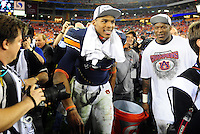 Jan 10, 2011; Glendale, AZ, USA; Auburn Tigers quarterback Cameron Newton (2) carries a Gatorade bucket and looks to dunk head coach Gene Chizik (not pictured) after defeating the Oregon Ducks 22-19 in the 2011 BCS National Championship game at University of Phoenix Stadium.  Mandatory Credit: Mark J. Rebilas-
