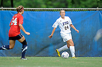 2 October 2011:  FIU midfielder Cortney Bergin (24) looks to pass the ball while being pursued by South Alabama defender Jessica Oram (24) in the second half as the FIU Golden Panthers defeated the University of South Alabama Jaguars, 2-0, at University Park Stadium in Miami, Florida.