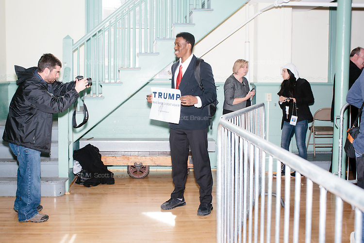 "Vincent Vaughns, 18, a high school senior at Phillips Exeter Academy, holds a campaign sign autographed by the candidate after real estate mogul and Republican presidential candidate Donald Trump spoke at a rally at Exeter Town Hall in Exeter, New Hampshire, on Thurs., Feb. 4, 2016. Vaughns said he is leaning towards Trump in the election. ""I wanted to hear straight from his face what he's going to do for America,"" he said."