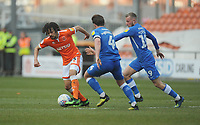Blackpool's Nya Kirby under pressure from Peterborough United's Alex Woodyard and George Cooper<br /> <br /> Photographer Kevin Barnes/CameraSport<br /> <br /> The EFL Sky Bet League One - Blackpool v Peterborough United - Saturday 13th April 2019 - Bloomfield Road - Blackpool<br /> <br /> World Copyright &copy; 2019 CameraSport. All rights reserved. 43 Linden Ave. Countesthorpe. Leicester. England. LE8 5PG - Tel: +44 (0) 116 277 4147 - admin@camerasport.com - www.camerasport.com
