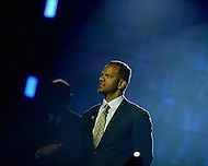 Canton, Ohio - August 1, 2014: Former NFL wide receiver Andre Reed waits as he is introduced to accept his gold jacket during the Pro Football Hall of Fame's class of 2014 enshrinement dinner in Canton, Ohio  August 1, 2014. During his 16 seasons in the NFL, Reed had 13 seasons with 50 or more pass receptions (2nd in the NFL).  (Photo by Don Baxter/Media Images International)