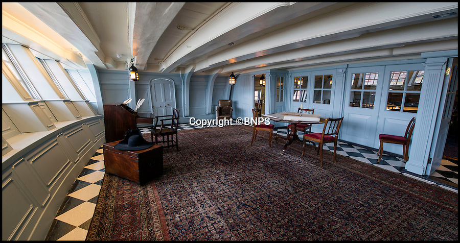 BNPS.co.uk (01202 558833)<br /> Pic: PhilYeomans/BNPS<br /> <br /> Nelsons minimalist day cabin now has 'baby blue' walls and a lovely new Persian carpet.<br /> <br /> Shiver me timbers - HMS Victory get's a dramatic makeover...its baby blue paint, a lovely new Axminster carpet, and a futon for Nelson.<br /> <br /> Admiral Lord Nelson's famous flagship has undergone a remarkable makeover that includes baby blue painted walls and a futon bed, after historians researched exactly how it looked at Trafalgar.<br /> <br /> Gone is the heavily varnished timber and Victorian wooden furniture that made the Great Cabin a dark and dingy place.<br /> <br /> Instead conservationists have adopted a less-is-more approach to interior design and the place where Britain's most famous sailor slept, ate and relaxed has become a more light and airy space.