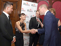 Prince William, Duke of Cambridge greets Aljaz Skorjanec and Janette Manrara with Jason Donovan during the Child Bereavement 25th birthday gala dinner at Kensington Palace in London. HRH is a patron of Child Bereavement UK. The charity works to help families to rebuild their lives after the devastation of child bereavement. Photo Credit: ALPR/AdMedia