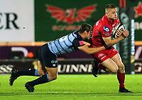 Johnny McNicholl of the Scarlets (R) is brought down during the Guinness PRO14 match between Scarlets and Cardiff Blues at Parc Y Scarlets Stadium, Llanelli, Wales, UK. Saturday 28 October 2017