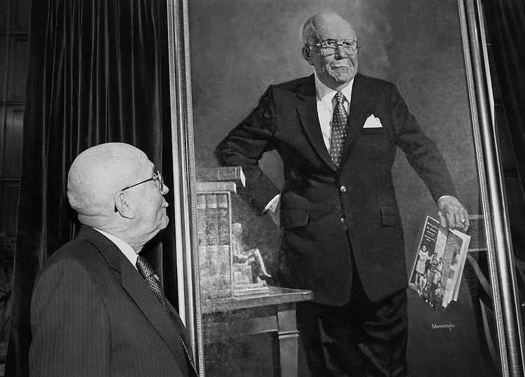 Rep. Augustus F. Hawkins, D-Calif. admiring his portrait, which was unveiled in the Education and Labor Committee Room in Rayburn Building.  The painting by Maniscalco, now hangs in the room. October 10, 1990. (Photo by Maureen Keating/CQ Roll Call)