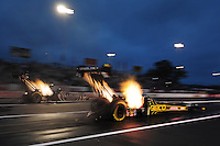 Jun. 1, 2012; Englishtown, NJ, USA: NHRA top fuel dragster driver Morgan Lucas (right) races alongside Shawn Langdon during qualifying for the Supernationals at Raceway Park. Mandatory Credit: Mark J. Rebilas-