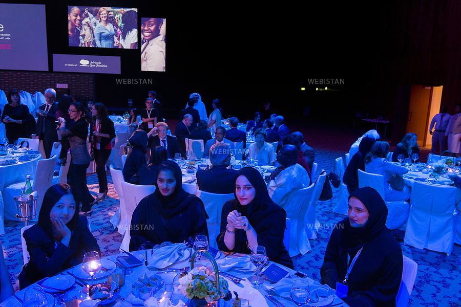 Qatar, Doha, Qatar National Convention Centre <br /> Opening night of the World Innovation Submit for Education 2012 (WISE): the guests' dinner. <br /> Each year, WISE gathers experts coming from all around the world and more than 100 countries, all invited by the Qatar Foundation. As a real soft power tool of the emirate, WISE places education at the centre of the institutional, political and economic debate.<br /> Qatar is one of the Arab peninsular emirates, on the Persian Gulf shoreline. Bordered by Saudi Arabia, Qatar's economy relies on oil and gas. Being the world's fourth-largest gas exporter, gas remains the major driver of Qatar's economy. The emirate is governed by Sheikh Tamim bin Hamad Al Thani who became at the age of 33 Emir of Qatar on 25 June 25th, 2013 after his father's abdication. He is the youngest emir at the head of an Arab State.<br /> On June 5th, 2017, Saudi Arabia, the United Arab Emirates, Egypt, Bahrain, Yemen, Libya, Mauritania, the Maldives, and Mauritius broke off diplomatic relations with Qatar, accusing the emirate of supporting several terrorist groups. As its Gulf neighbours enforced the closure of all land, air and sea borders to Qatar, the country is quarantined.<br /> 