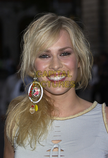 NATASHA BEDDINGFEILD.GQ Men of the Year Awards, Royal Opera House, London, 7th September 2004..portrait headshot large hoop earring beads side ponytail messy hair.Ref: PL.www.capitalpictures.com.sales@capitalpictures.com.©Capital Pictures.