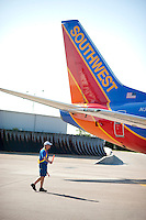 Michael Smith (cq) directs a Southwest Airlines plane for takeoff at Love Field Airport in Dallas, Texas, Wednesday, October 27, 2010...PHOTO/ MATT NAGER