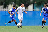 2 October 2011:  FIU midfielder/forward Mario Uribe (17) moves the ball upfield while being pursued by Kentucky midfielder Matt Lodge (6) and midfielder Steve Cabos (14) in overtime as the FIU Golden Panthers defeated the University of Kentucky Wildcats, 1-0 in overtime, at University Park Stadium in Miami, Florida.