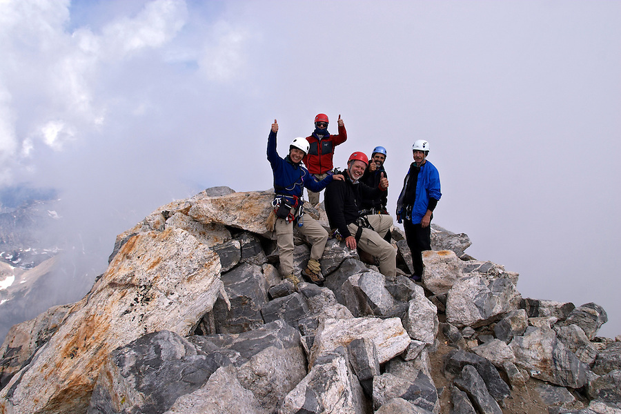 Climbers celebrating on summit of the Grand Teton, Grand Teton National Park, Teton County, Wyoming, USA
