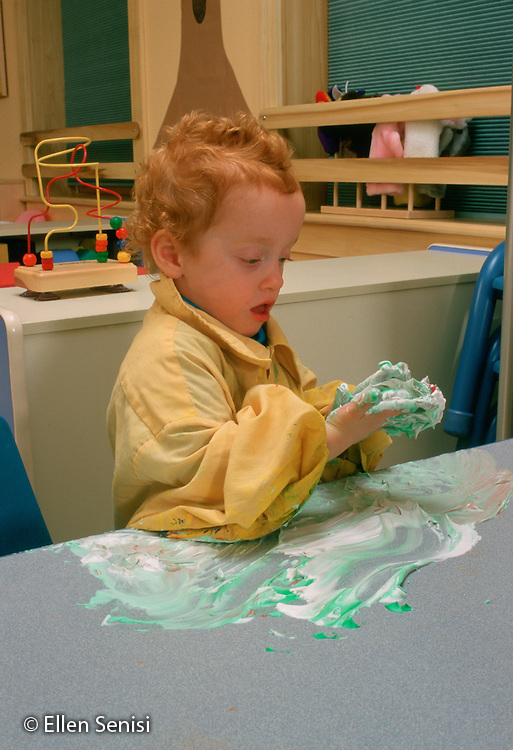 MR/Schenectady, New York.Schenectady DayNursery: private, non-profit daycare.Toddler class / Girl (30 months) does art project with shaving cream and food coloring..MR:Rob6      FC#:23673-00306.scan from slide.© Ellen B. Senisi
