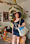 Brooklyn; New York; U.S. - August 9; 2014 - TRACIE DEE, of Brooklyn, poses next to Spook-A-Rama Cyclops at The Fourth Annual History Day at Deno's Wonder Wheel Amusement Park and Coney Island History Project.