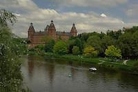 Schloss Johannisburg castle overlooking the River Main and castle gardens. Aschaffenburg, Bavaria, Germany.