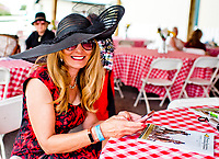 FRANKLIN, KY - SEPTEMBER 08: A fan shows off her fashionable hat on Kentucky Turf Cup Day at Kentucky Downs on September 8, 2018 in Franklin, Kentucky. (Photo by Scott Serio/Eclipse Sportswire/Getty Images)
