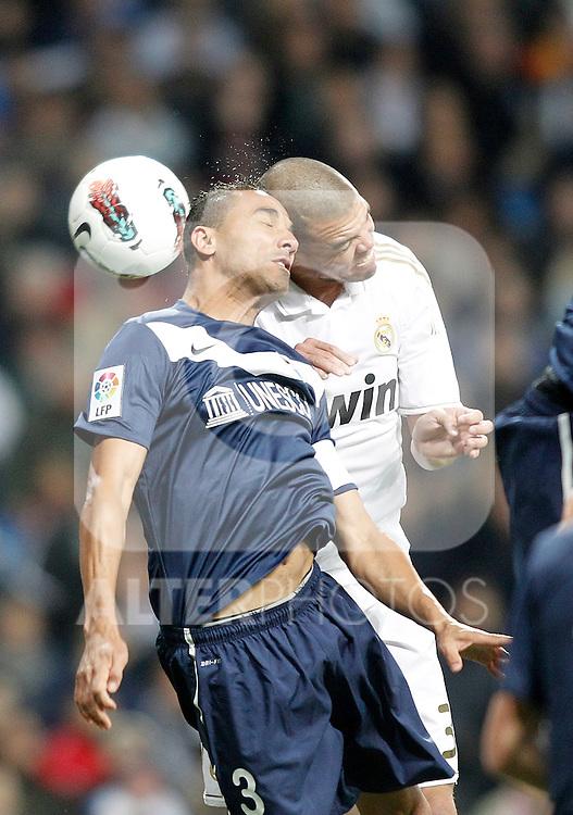 Real Madrid's Pepe against Malaga's Robson Oliveira Weligton during La Liga Match. March 18, 2012. (ALTERPHOTOS/Alvaro Hernandez)