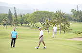 United States President Barack Obama watches as his colleague putts and Sam Kass, left, looks on, at the 18th hole at the Mid Pacific Country Club in Lanikai, Hawaii on January 1, 2014.<br /> Credit: Cory Lum / Pool via CNP