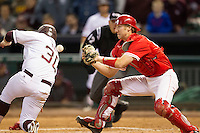 Houston Cougar catcher Caleb Barker #27 drops the ball as Texas A&M Aggie baserunner Mitchell Nau #3 slides home in the NCAA baseball game on March 1st, 2013 at Minute Maid Park in Houston, Texas. Houston defeated Texas A&M 7-6. (Andrew Woolley/Four Seam Images).