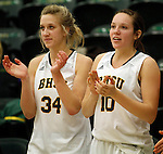 JANUARY 6, 2015 -- Jennie Scharn #34 and Remi Wientjes #10 of Black Hills State cheer from the bench during their college women's basketball game against South Dakota Mines Tuesday evening at the Donald E. Young Center in Spearfish, S.D. At right is Mackenzie Kenney #40 of South Dakota Mines.  (Photo by Dick Carlson/Inertia)