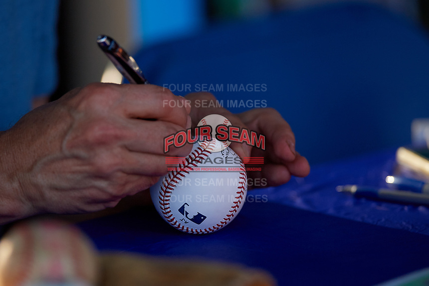 Actor Dwier Brown autographs a baseball during a Florida State League game between the Charlotte Stone Crabs and Clearwater Threshers on May 17, 2019 at Spectrum Field in Clearwater, Florida.  Charlotte defeated Clearwater 12-4.  (Mike Janes/Four Seam Images)