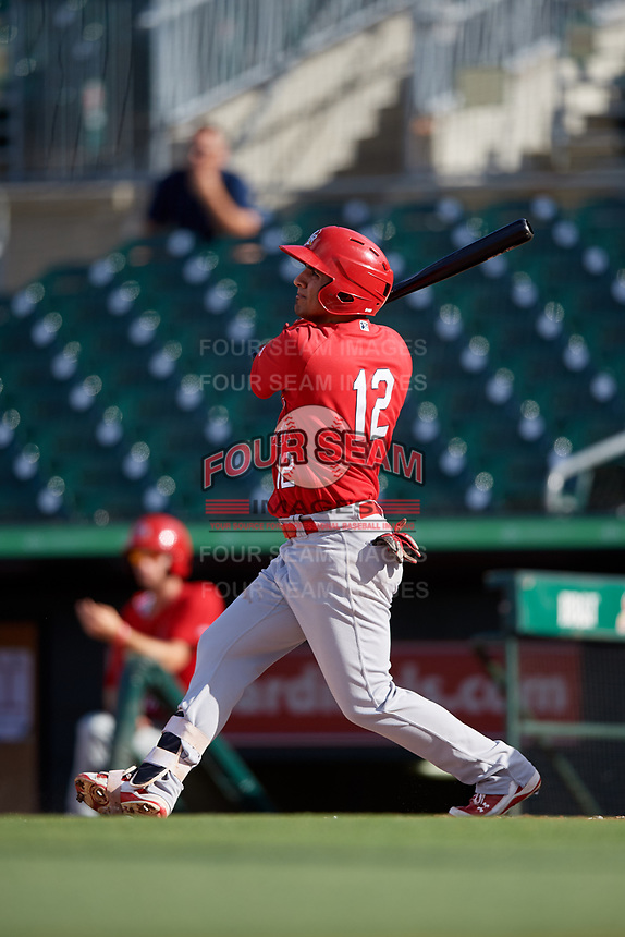 Palm Beach Cardinals third baseman Jose Martinez (12) follows through on a swing during a game against the Jupiter Hammerheads on August 4, 2018 at Roger Dean Chevrolet Stadium in Jupiter, Florida.  Palm Beach defeated Jupiter 7-6.  (Mike Janes/Four Seam Images)