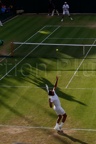 02.07.2016. All England Lawn Tennis and Croquet Club, London, England. The Wimbledon Tennis Championships Day Six. Number 12 Jo Wilfried-Tsonga (FRA) serves during his singles match against number 18 seed, John Isner (USA) in the evening shadows on Court 2.