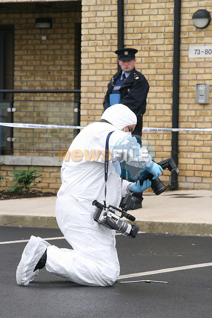 Suspected evidence being photographed at the scene of the murder of a teenage Nigerian man at The Court Apartments, Dunboyne Castle, Meath...Photo NEWSFILE/Jenny Matthews.(Photo credit should read Jenny Matthews/NEWSFILE)....This Picture has been sent you under the condtions enclosed by:.Newsfile Ltd..The Studio,.Millmount Abbey,.Drogheda,.Co Meath..Ireland..Tel: +353(0)41-9871240.Fax: +353(0)41-9871260.GSM: +353(0)86-2500958.email: pictures@newsfile.ie.www.newsfile.ie.FTP: 193.120.102.198.