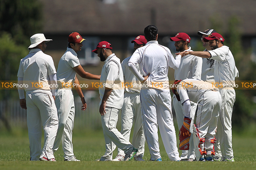 Barking celebrate the wicket of M Hussain during Newham CC vs Barking CC, Essex County League Cricket at Flanders Playing Fields on 10th June 2017