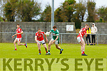 Listrys Anyhony Kennedy in possession as St Pats Liam Poff keeps on eye on his advance in Division 3 of the Senior Football County league on Sunday in Blennerville