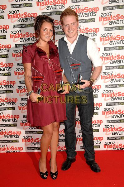 LACEY TURNER & CHARLIE CLEMENTS.Inside Soap Awards, Gilgamesh, Camden, London, .England, September 24th 2007..full length award grey waistcoat red dress.CAP/FIN.©Steve Finn/Capital Pictures.