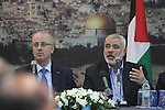 Senior Hamas leader Ismail Haniyeh speaks during the visit of Palestinian Prime Minister Rami Hamdallah, at Haniyeh's house in Gaza city on October 9, 2014. The Palestinian unity government which took the oath of office in June under technocrat prime minister Rami Hamdallah arrived to Gaza Strip on Thursday to convene the first fully meeting. Hamdallah said that the unity government will rebuild the bombed-out Gaza Strip following a seven-week Israeli offensive. Photo by Mohammed Asad