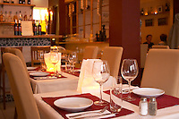Tables set for guests at the gastronomic Italian restaurant Fantozzi on Soder with wine glasses cutlery, napkins plates and candles in paper bags Stockholm, Sweden, Sverige, Europe