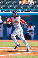 Amed Rosario (1) of the Brooklyn Cyclones follows through on his swing against the Hudson Valley Renegades at Dutchess Stadium on June 18, 2014 in Wappingers Falls, New York.  The Cyclones defeated the Renegades 4-3 in 10 innings.  (Brian Westerholt/Four Seam Images)