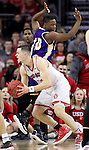 SIOUX FALLS, SD: MARCH 4: Matt Mooney #13 of South Dakota gets Ryan Maas #10 of Western Illinois off the ground and drives on March 4, 2017 during the Summit League Basketball Championship at the Denny Sanford Premier Center in Sioux Falls, SD. (Photo by Dick Carlson/Inertia)