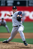 OAKLAND, CA - Roger Clemens of the New York Yankees in action during a game against the Oakland Athletics at the Oakland Coliseum in Oakland, California in 1999. Photo by Brad Mangin