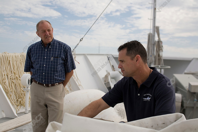 The end of the Space Shuttle program. John Fischbeck (left) leader of the crew and Bren Wade (right) captain of the boat Liberty Star that retrieves the solid fuel boosters after they fall into the ocean off the coast of Florida during a shuttle launch. Patrick Air Force base, Cape Canaveral, Florida, April 30, 2010