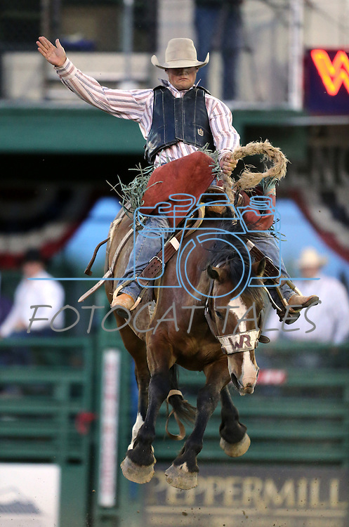 CoBurn Bradshaw rides in the saddle bronc competition at the Reno Rodeo in Reno, Nev. on Friday, June 19, 2015.<br /> Photo by Cathleen Allison/Nevada Photo Source