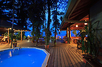 Walindi Resort pool, bar  and dining area at dusk, New Britain Island, Papua New Guinea.