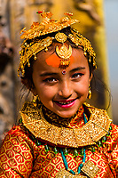 "Young Nepali girls in costume for Bel Bibaha. Nepali females are married three times in their lives: FIrst, Bel Marriage is a ceremony in the Newar community in Nepal in which pre-adolescent girls are ""married"" to the bael fruit, which is a symbol of the god Vishnu, ensuring that the girl becomes and remains fertile. Swcond time is to the Sun. The third time is to man. Bhaktapur, Kathmandu Valley, Nepal."