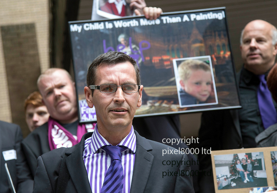 """Pic shows: Tim Harries  - glasses - purple tie - after appearing at Southwark Crown Court today. 17.9.13<br /> <br /> Behind him is a mock up of the defaced painting with the words """"help"""" across a portrait of the queen.<br /> <br /> A Fathers4Justice campaigner appeared in court today accused of defacing a portrait of the Queen in Westminster Abbey.<br /> <br /> Tim Haries, 41, is alleged to have smuggled a can of spray paint into the abbey yesterday before defacing the picture.<br /> <br /> He appeared at Court charged with criminal damage of more than £5,000.<br /> <br /> <br /> <br /> <br /> Pic by Gavin Rodgers/Pixel 8000 Ltd"""
