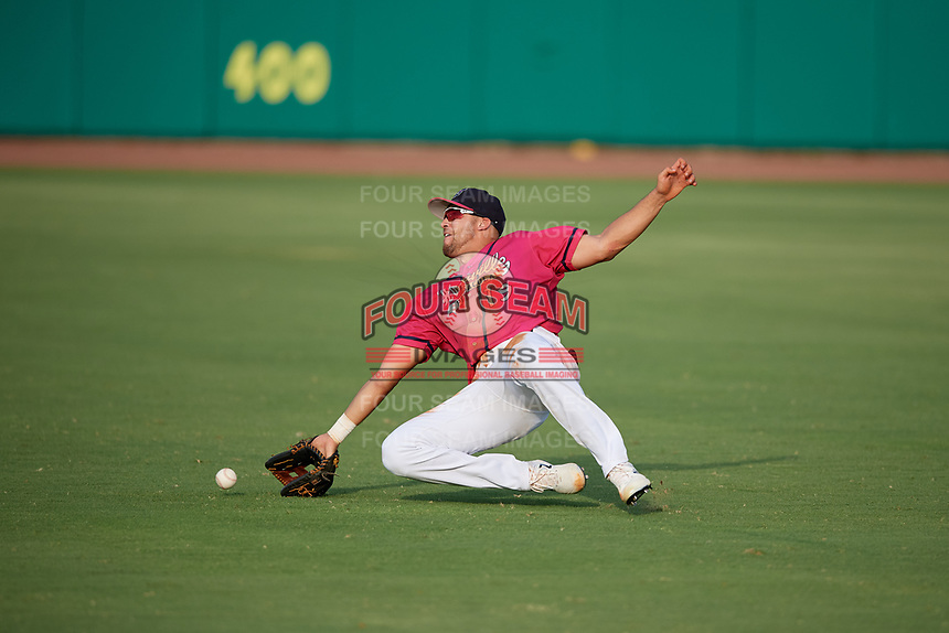 Pensacola Blue Wahoos right fielder Alex Kirilloff (19) attempts to catch a fly ball during a Southern League game against the Mobile BayBears on July 25, 2019 at Hank Aaron Stadium in Pensacola, Florida.  Pensacola defeated Mobile 2-1 in the first game of a doubleheader.  (Mike Janes/Four Seam Images)