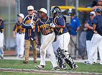 Boca Ciega Pirates Darius Blasingane (10) and catcher Ivan Rodriguez (12) celebrate after a game against the Lakeland Spartans at Boca Ciega High School on March 2, 2016 in St. Petersburg, Florida.  Boca Ciega defeated Lakewood 2-1.  (Mike Janes/Four Seam Images)
