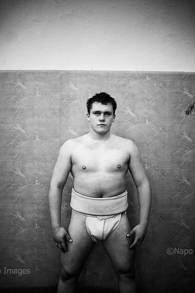 Krotoszyn 03.10.2010 Poland<br /> Mateusz Kedzierski, bronze medal.<br /> Poles do not know much about sumo. Japan's national sport remains a mystery, except for the image of the very big and fat sumo wrestlers. However Polish sumo wrestlers have been, for many years, classified among world's leading sportsmen in this field. Since 1995 more and more followers join the sumo sections, fascinated with the art of fighting on the clay dohyo.<br /> Photo: Adam Lach / Napo Images<br /> <br /> Mateusz Kedzierski, zdobywca brazowego edalu na misztrzostwach polski.<br /> Polacy niewiele wiedza o sumo. Narodowy sport Japonii to wciaz tajemnica. Kojarzy sie jedynie z wielkimi i grubymi mezczyznami. Jednak zawodnicy z Polski od lat naleza do swiatowej czolowki w tej dyscyplinie. Od 1995 roku w sekcjach sumo przybywa zawodnik&oacute;w zafascynowanych zmaganiami na glinianym dohyo.<br /> Fot: Adam Lach / Napo Images